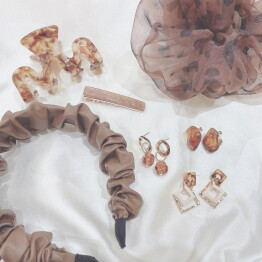 brown accessories 🧸🕰🥨